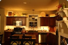 love the soft lighting- under mount cabinet lights and rope lights above cabinets