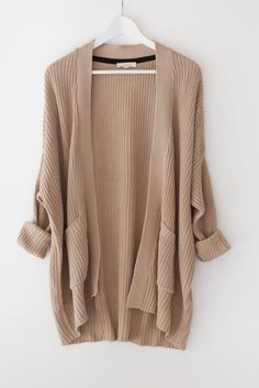 "Tan chunky knitted cardigan with an open front Large patched front pockets Long sleeves Dropped shoulder and a loose fit Size small measures approx. 30"" in leng"