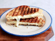 Cacio e Pepe Grilled Cheese : Make a sandwich with 2 pieces of white bread and 3 slices (about 2 1/2 ounces total) of a semisoft cheese such as Pecorino Toscano, Manchego or provolone. Melt 1 tablespoon butter and 1 teaspoon extra virgin olive oil in a medium nonstick skillet over medium-low heat. When the butter is foamy, sprinkle 1 teaspoon grated Pecorino Romano and 1/2 teaspoon coarsely ground black pepper into the pan. Place the sandwich on the pepper mixture and cook until the bread…