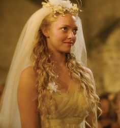 "Wedding attire of Amanda Siefried in movie ""Mama Mia"" set in Greece"