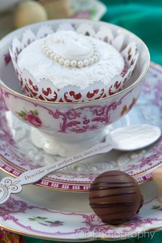 Vintage crockery hire, tea cups and saucers are practical and pretty for a vintage tea party. Trivia tea spoons are a great way to get the conversation started by www.fuschiadesigns.co.uk, £4.99