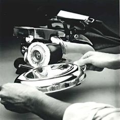 Polishing a silver platter with the optional Handi-Butler attachment and the Kirby Heritage vacuum model in the early 1980s.