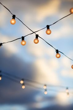 "White ""carnival"" lights for indoors and outdoors. (Style Me Pretty - Photos By Kristyn Hogan - http://www.stylemepretty.com/gallery/picture/446748#)"