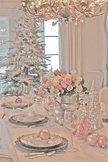 Pretty pink Christmas tablescape. So white and clean and pretty with the glass, silver and pink accents! Love this!