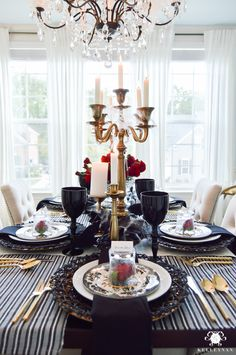 Gothic Halloween Dinner Party with Candelabras and Crystal Chandelier in Elegant Dining Room