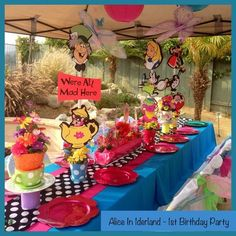 Children's party table at an Alice in Wonderland Birthday Party!    See more party ideas at CatchMyParty.com!  #partyideas #alice
