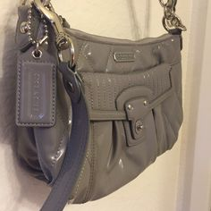 Patent Leather Coach Handbag Barely used grey Coach handbag with purple lining on the inside. Long Strap is removable Coach Bags Crossbody Bags