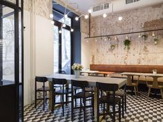 Nude. Coffee & Wine Bar is a small family establishment located in a 1930s residential building in the picturesque heart of Moscow. The design was informed b...