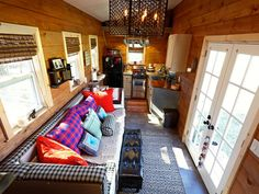 This is the 276 sq. Nomad's Nest tiny house on wheels designed and built by Wind River Tiny Homes in Chattanooga, Tennessee. In fact, Jeremy & Lindsay Weaver, of Wind River Tiny Homes, are .