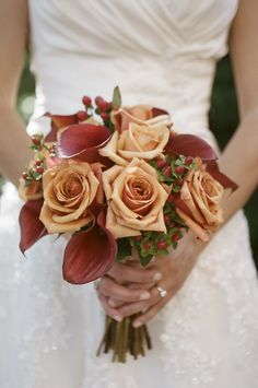 #bridal #bouquet of red sox calla lilies and milva roses with hypericum berries | bergeronsflowers.com | briantropianophoto.com