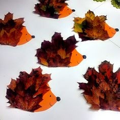 """Here's one to make with the kids: Use purple and red leaves on brown paper to make these adorable leaf """"hedgehogs."""" Get the tutorial at Crafty Morning."""