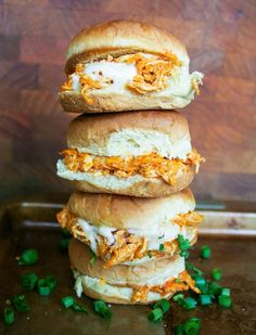 buffalo chicken sliders are made with shredded chicken wing sauce seasonings cheese and ranch dressing piled onto a slider bun and baked. they're easy delicious and perfect for any party! Pollo Buffalo, Costco Rotisserie Chicken, Buffalo Chicken Sliders, Chicken Recipes For Two, Shrimp Recipes, Salmon Recipes, Ranch Recipe, Slider Recipes, Sandwich Recipes