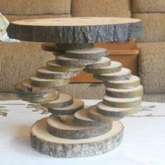 This cake stand is made of all natural tree wood slices. They are hand crafted one at a time. They form the ideal base for wedding cakes,cupcake displays,store fronts etc etc The stand measures about 18 tall.Top wood slice is about 10 wide.Bottom slice is about the same width or a little smaller.