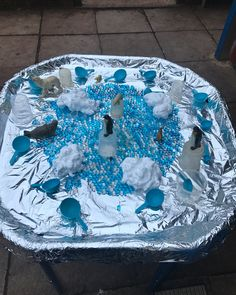 Today's Arctic and Antarctica themed tuff tray. Water beads, shaving foam and foil, complete with animals. 🐧🌨❄️#tufftray #outdoorlearning…