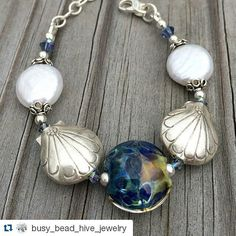 #Repost @busy_bead_hive_jewelry  Chesapeake Bay bracelet for sale in my Etsy shop  http://ift.tt/1PlbrJB #bracelet #beadedjewelry #crafty #crazyforjewelry #etsy #handmade #handcraftedjewelry #jewelry #jewelryfreak #jewelryforsale #lovemypearls #lampwork #pearls #sterlingsilver #Swarovskicrystal #hilltribesilver #chesapeakebay #artisanjewelry #crystal #coinpearls #lampworkbeads #lampwork_beads #lampworkjewels #lampworkjewelry #etsyusa #Maryland