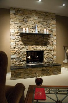 Stone Veneer Fireplace - would love to cover our red brick wall in family room with this!!
