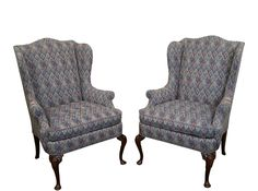"""A pair of Hickory, mahogany, queen anne wing chairs that are approximately 25 years old and were made in America.   Store Item #: 11291 ax  DETAILS/DESCRIPTION: High quality, solid mahogany, 18th century style pair of Queen Anne wing chairs labeled, """"Hickory Chair"""".   CONDITION REPORT: Traditional style, clean vintage condition.   MEASUREMENTS: H: 45"""" x W: 32"""" x D: 27.25"""" x Seat H: 23"""" x Arm H: 26.25"""""""
