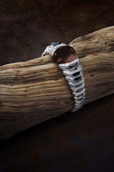 L'Odyssée de Cartier Parcours d'un Style high jewelry bracelet in white gold, set with a 88.73ct cabochon-cut brown tourmaline, obsidian and...