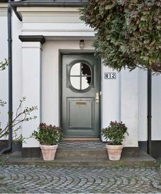 gray green door with round window