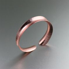 Handcrafted Chased Anticlastic Copper Bangle Bracelet. Add some glam to any outfit!   http://www.johnsbrana.com/chased-anticlastic-copper-bangle-bracelet.html  $60.00