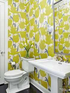 Chartreuse blooms and gray leaves on statement wallpaper bring color to this stand-out bathroom: http://www.bhg.com/bathroom/color-schemes/colors/bathroom-color-schemes/?socsrc=bhgpin041815chartreusegraywhite&page=1
