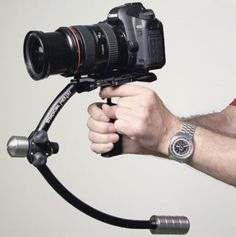 """If you've been enjoying shooting HD video with your DSLR as much as we have, Steadicam's Merlin camera rig is an essential traveling companion. Weighing just 13 ounces, the Merlin is one of the lightest rigs on the market and ideal for """"floating"""" your camera in tight shooting situations."""