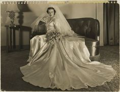 1950 Okay, while this dress is awesomely dramatic, I am pinning this bc of the baby's breath bouquet-- note to future self!