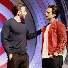 Chris Evans and Sebastian Stan attend a press conference for Captain America: Civil War in Beijing, China.