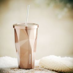 A stainless steel faceted Cold Cup with double wall, reusable straw and rose-gold finish. Starbucks.