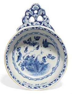 AN ENGLISH DELFT BLUE AND WHITE NAMED AND DATED PORRINGER OR BLEEDING BOWL