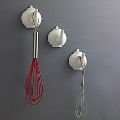 Kitchen utensil hooks.  What I really need is just a 2-D teapot sticker minus spout, because the Command hooks would look pretty spout-y.