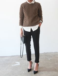 Pretty much the perfect outfit. All classic pieces that will last a long time: black trousers, white button-down, cable knit sweater and pointy toe pumps.