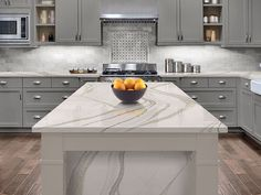Quartz is one of the most durable surface you can add to your kitchen arsenal.   The question is what color do you like . . . .. . . .