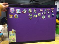 """16""""x20"""" canvas covered with fabric. Disney eeyore pin display ."""
