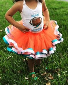 Handmade tutus are perfect for all occasions; newborn pictures, birthdays, milestones…  Handmade Miami Dolphins Inspired Sewn Tutu with Orange and Turquoise Ribbon Edge Shown in 2T-4T  Waistbands:  made with 1-inch non-roll elastic, will stretch 2-3 inches to accommodate growth. Available sizes 0-6 months to 10-12 years old, further sizes available upon request. For more information visit www.etsy.com/shop/nandltutus or contact me at karenmonchi@aol.com  Other sizes are available upon…