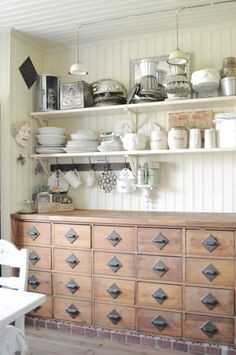 I love the idea of a piece of furniture like a dresser instead of built in cabinets and open shelves are fun