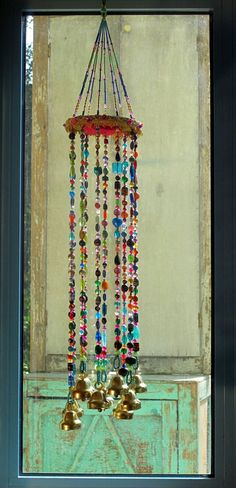 Wind chimes beaded mobile with Brass bells sun by RONITPETERART.  This would be a great way to use up all those beads I collected to make jewelry  The old metal movie reel would be put to good use,too