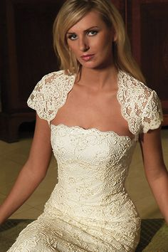 Strapless A-line gown with lace overlay and Organza sash.