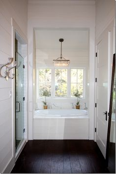 Hardwood Floor In Bathroom like this White Bathroom With Dark Hardwood Floors