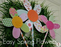 tutorial for spring flowers made from scrapbook paper and wood shapes.  Easy and cute.