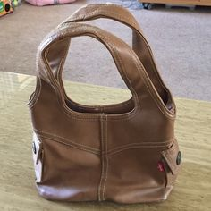 Levis purse Gently used brown Levi's purse small handed tote with two  side pockets inside zipper and  two inner  pouches Levi's Bags Mini Bags