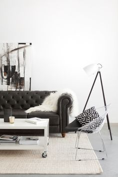 HOW TO FURNISH YOUR TORONTO AIRBNB LISTING | We chose one statement piece to add some serious character to this space. The tufted leather-look Cardiff sofa is timeless in style, but strong enough to create a visual impact. It's worthwhile investing in key quality pieces, like a sofa in a highly resistant material. Not only will it withstand the high traffic of a rental, it will wear beautifully and create visual interest in your listing photos.