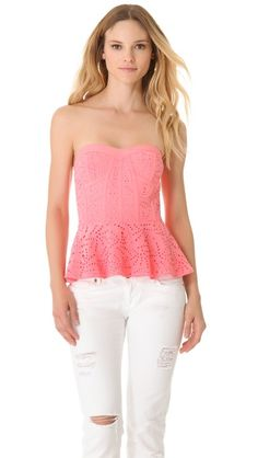 Rebecca Taylor Eyelet Bustier Top. So romantic and pretty, especially in a feminine bubblegum pink. Love the bustier style and the way they styled it with destroyed white denim-an effortlessly chic summer look.