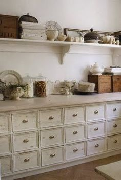 FOR PUPA!!!!! amazing vintage drawers built into the kitchen