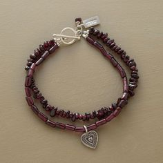 """DOUBLE GARNET BRACELET -- Garnets two ways: one strand of chips another of cylinder beads. The latter dangles a sterling silver heart charm. Toggle clasp. Ours exclusively, handcrafted in USA. Approx. 7-1/2""""L."""