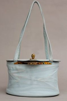 50s KORET Powder Blue Supple LEATHER OVAL Novelty Clasp BOX HANDBAG.  RARE piece made of an incredibly supple powder blue leather.  This beautiful find features a jewel tone opulent peau de soie lining, large oval mirror + chain attached coin purse.  Geometrical flap, hardware turnkey, novelty face shaped closure. Large Oval Mirror, Jewel Tones, Face Shapes, Gym Bag, Coin Purse, Powder, Hardware, Closure, Jewels