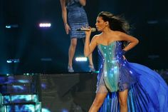 High Tech Silk Chiffon Dress. Azerbaijani singer and saxophonist, Safura Alizadeh, awed the fans of Eurovision 2010 with her futuristic fashion statement...a VJ controlled gown that featured 5400 LEDs. The gown was designed by London-based Francesca Rosella and Ryan Genz of CuteCircuit.