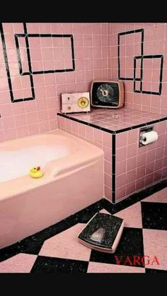 pink and black bathroom. My grandparents had a black shower tiled stall - with pink flamingos on feature tiles and a pink bath and separate pink toilet with black porcelain lid - I thought it was beautiful