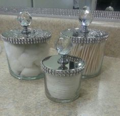 Diy... reuse bath and body works candle jars. Glam them up by simply adding bling on a roll and cabinet knobs.