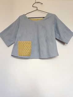 gallery - 100 Acts of Sewing | number 74 |materials: denim and cotton print |pattern: tunic no. 1|  Love how she uses a coloured binding, and that it's the same colour, but not necessarily the same pattern as the pocket